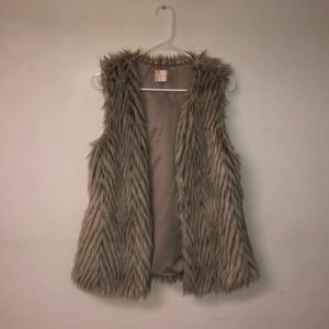 Grey and brown waist length fur vest